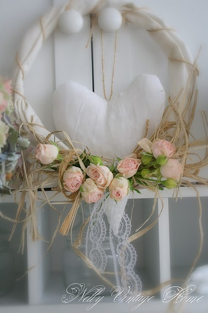 Soft and romantic looking, love this lace and raffia look. Looks like the wreath is made of tulle. Great idea with the heart center.