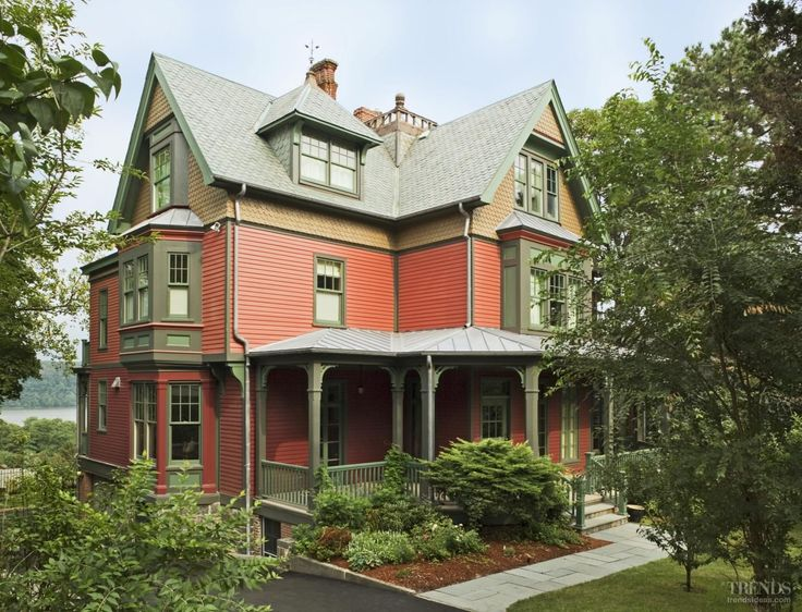 A rich color palette of red, brown and green reflects the home's original exterior.