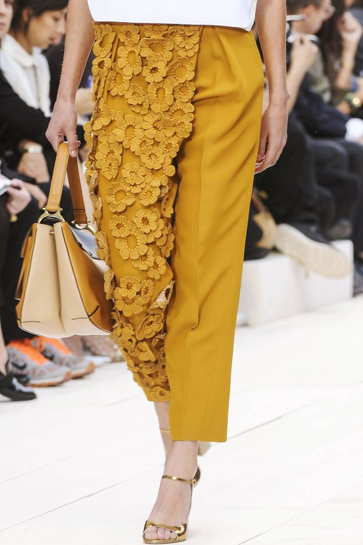 Asymmetry in Fashion - mustard tailored trousers with floral applique along one leg; interesting garment details // Chloé