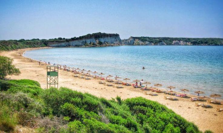 Gerakas beach Zakynthos: Kilometres of sand, exotic beauty, warm, shallow sea water. The carettas lay their eggs here too.