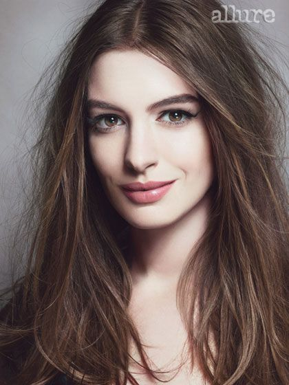 Anne Hathaway. Love the makeup and the hair.