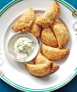 Spiced Beef Empanadas With Lime Sour Cream|Get ahead of the game: The empanadas can be assembled and frozen up to 1 month in advance. Freeze them, unbaked, on a parchment-lined baking sheet until firm, then transfer them to a resealable plastic bag. To cook, bake from frozen at 375º F for 30 to 45 minutes
