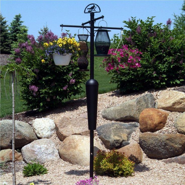 25 best ideas about squirrel proof bird feeders on - Bird feeder garden designs ...
