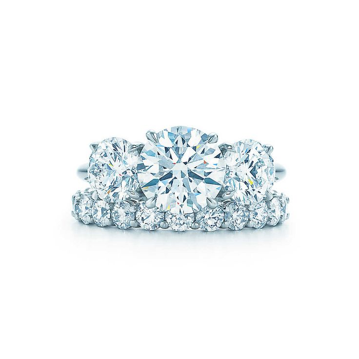 Three round brilliant Tiffany diamonds are <br>painstakingly matched for color, quality and <br>proportion. The classic three-stone combination.