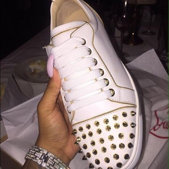 Christian Louboutin sneakers. I'm selling a pair of Christian Louboutin sneakers.. All white with real gold spikes also genuine leather inside out! Christian Louboutin Shoes Sneakers