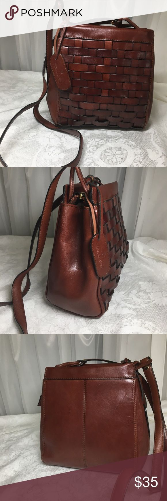 "Etienne Aigner Vintage Woven Brown Leather bag Etienne Aigner Vintage Woven Leather Crossbody bag. Genuine Leather. It looks phenomenal. Minor wear appropriate with age.. Purse has only one  compartment. No stains, no tears or rips. Made in china. 8"" W x 9 1/2"" H 3 1/2""D Etienne Aigner Bags"