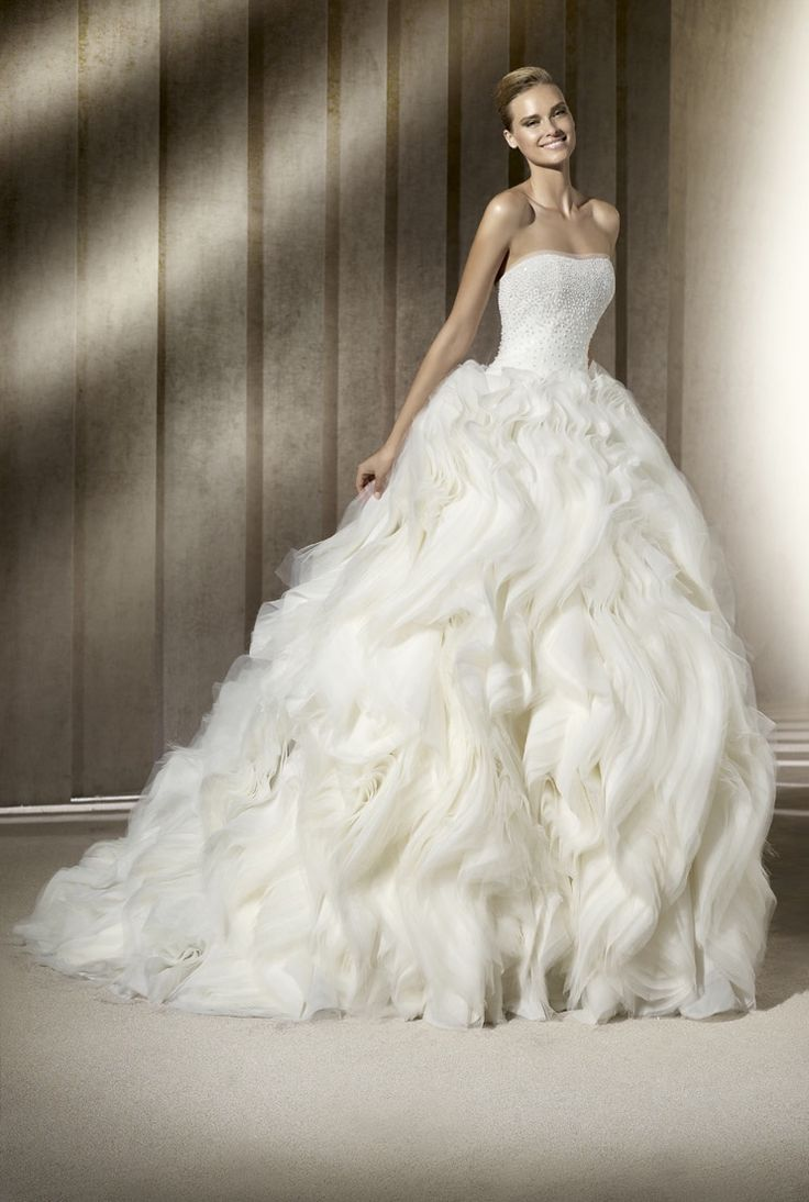 Dramatic ballgown wedding dress with layered skirt. I'm obsessed with the skirt of this dress like ahhhhh.