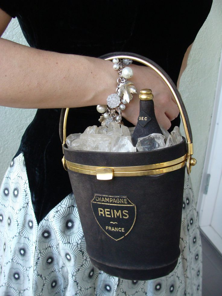 "Best. Handbag. Ever. ""Champagne bucket in black suede, with lucite ice cubes and black suede champagne bottle. Made by Anne Marie of Paris, and reportedly given as a New Year's present to the guests of Hotel Meurice in the late ′40s. This purse also exists in white."""