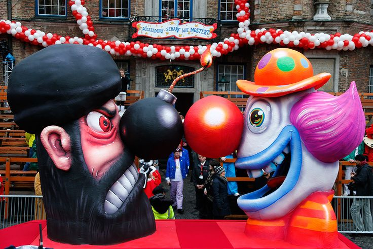 Parade floats on Rosen Montag often display controversial political topics and ideas. This float represents the carnival spirit and happiness of the festival being held in spite of the dangers of terrorism. It also compares radical terrorists to clowns.