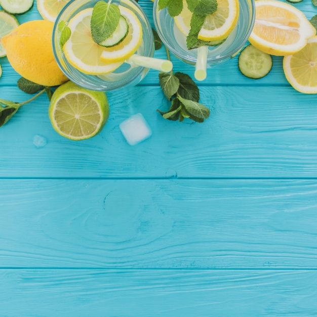 Top view of blue wooden surface with summer drinks Free Photo