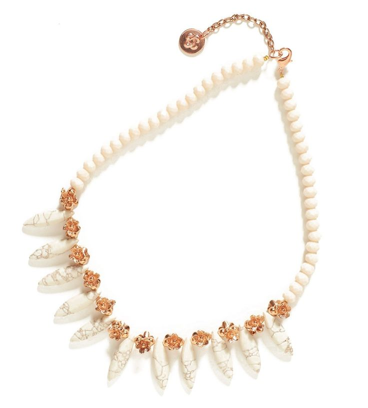 A statement necklace makes a great addition to any outfit. Find the spike necklace at Maggie T.
