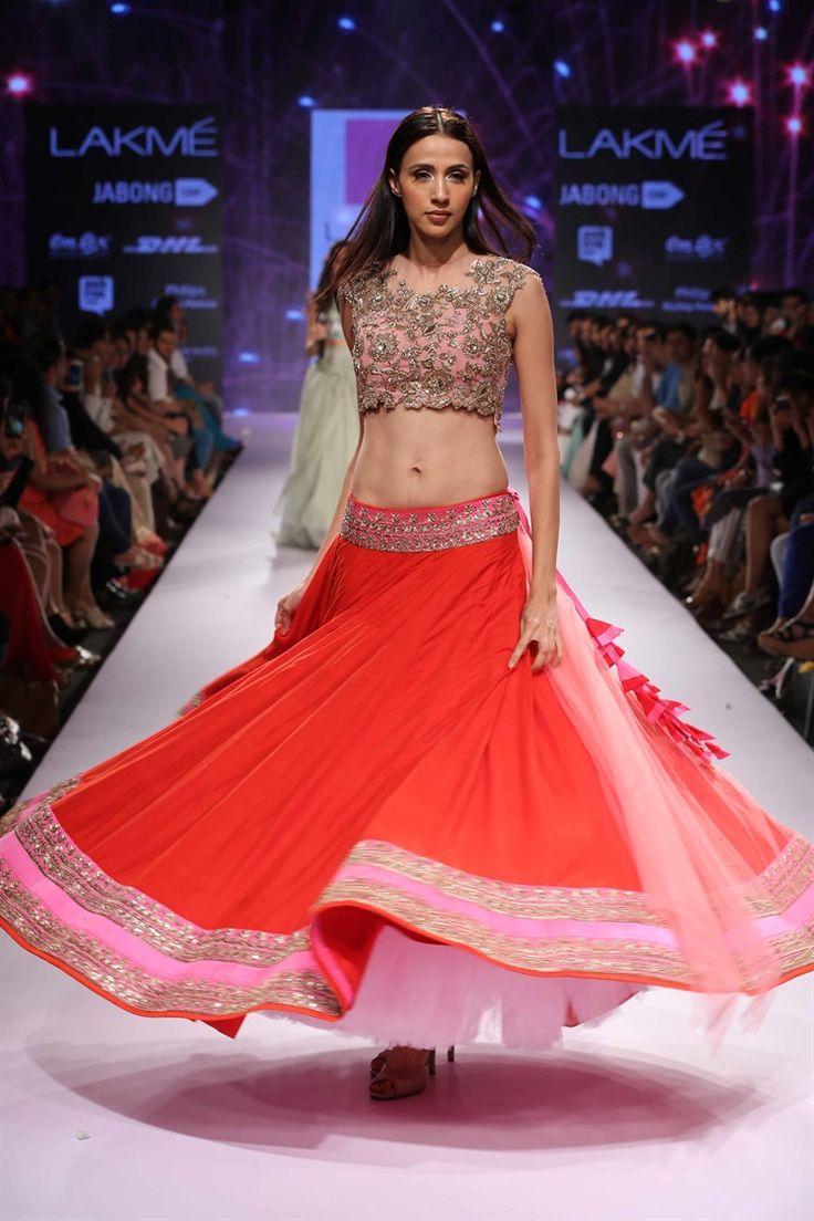 love the simple red lengha skirt with detailed border and heavily decorated top| Anushree Reddy's Royal Collection at Lakme Fashion Week 2015