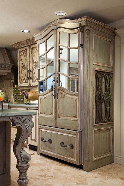 this 'fridge is genius. The mirrored doors take it past custom to true lux.  Pretty sure you won't be seeing this at the Home Depot next year! Pointing out one more fab detail- the gorgeous curvy leg on the island is a salvaged piano leg! Now that is a repurpose project!