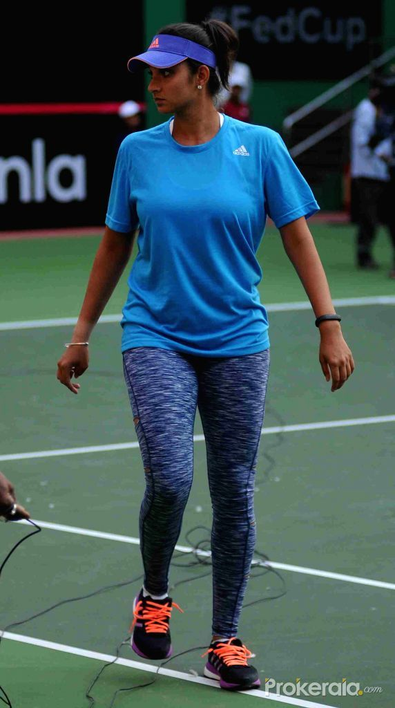 Indian Tennis Player Sania Mirza During A Tennis Match In Hyderabad On April 15 2015 In 2020 Tennis Match Tennis Players Female Tennis Stars