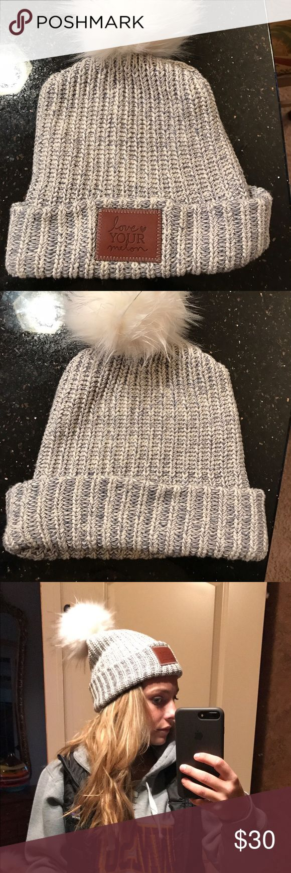 Love Your Melon cuffed beanie with Pom Love Your Melon cuffed winter hat with Pom attached. Pom is connected by a button and can be removed. Love this hat but I have too many hats like this! Hat is currently sold out on website-highly desired! Cheaper on Ⓜ️erc :) Patagonia Accessories Hats