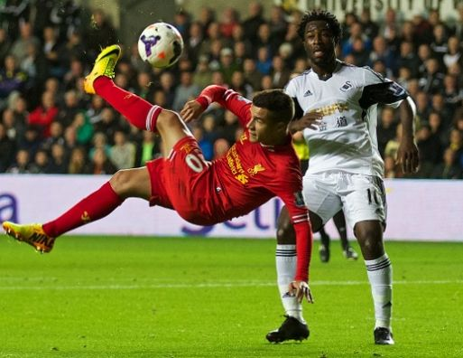Philippe Coutinho tries an audacious bicycle kick that went wide.