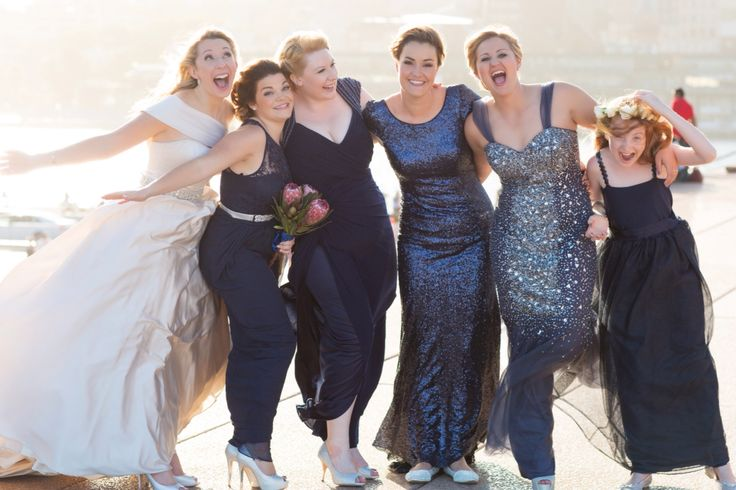 Sydney Wedding Mismatched bridesmaids, navy and silver Photography: Milque Photography Bridesmaids dresses: J'adore, Forever New. Junior Bridesmaid: made by Bride's mother, sydney opera house, maggie sottero dress, fun bridesmaid photo