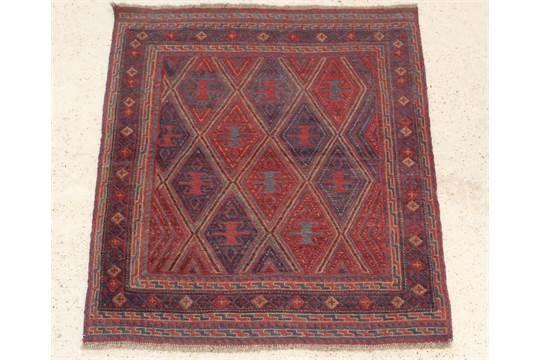 """A contemporary red and blue ground Gazak rug 52"""" x 47"""""""