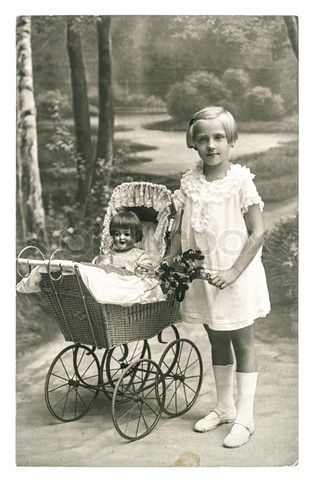 Image of 'BERLIN, GERMANY - CIRCA 1930: old photo of little girl with doll toy. nostalgic vintage picture from ca. 1930, in Berlin, Germany'