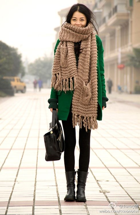 Big scarves, coats, and boots. Winter style.