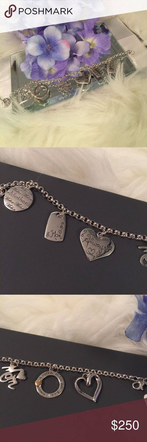 Lia Sophia Bracelet Surprise Mom with a BEAUTIFUL Lia Sophia MOM Charm Bracelet that says it all! Beautiful little sayings in every charm! The perfect gift for Mom! Sterling Silver! 7.5 in! 6 charms! NWT! Comes with box in pic!💖Has a hint of gold in one of the charms as shown in pic😉 Lia Sophia Jewelry Bracelets