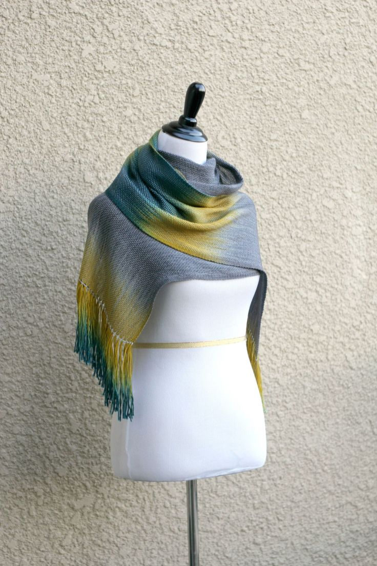 """Hand woven scarf, pashmina with gradually changing colors from silver grey to mustard and dark teal. Measures:L: 78"""" with 6"""" fringe on both ends W: 11""""Care instructions:Thi... #kgthreads #accessories #cozy #fall #fashion #gift #gradient #unisex #women #wrap"""