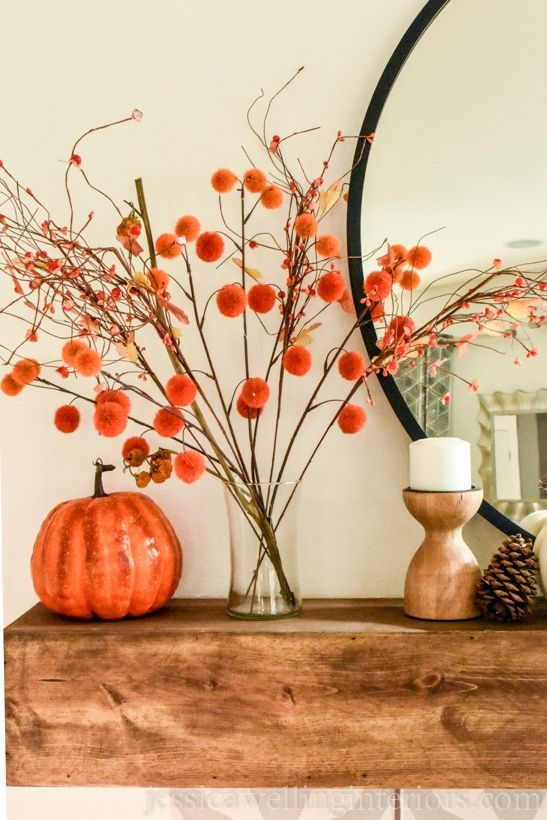 Modern Fall Mantle Decor Warm up your fireplace this Autumn with these simple and modern boho Fall mantle decor ideas! Bring in an orange and mustard yellow color pallette for Fall with pumpkins. stems, and throw pillows. Modern Fall Decor, Fall Home Decor, Autumn Home, Modern Boho, Fall Apartment Decor, Modern Mantle, Modern Halloween Decor, Fall Fireplace Decor, Fall Mantel Decorations