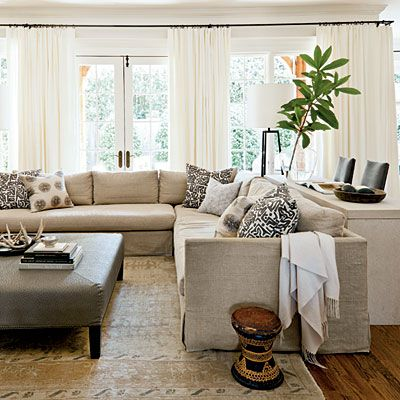 Strategically hung over the walls instead of the windows, long white curtain panels soften the space but don't block the light.