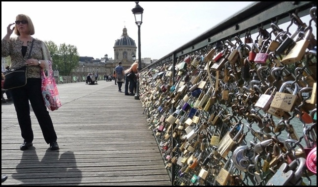 The Love Lock Bridge:  On this bridge lovers place a lock on the chain link part of the bridge, and then they throw the key in the Seine river.