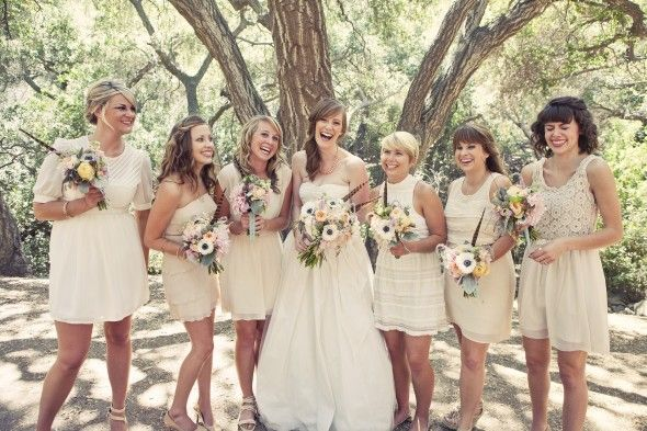 I like that they are wearing different styles, but same color dresses!  Look at the bouquets.  Vintage Style California Wedding: Carly   Billy