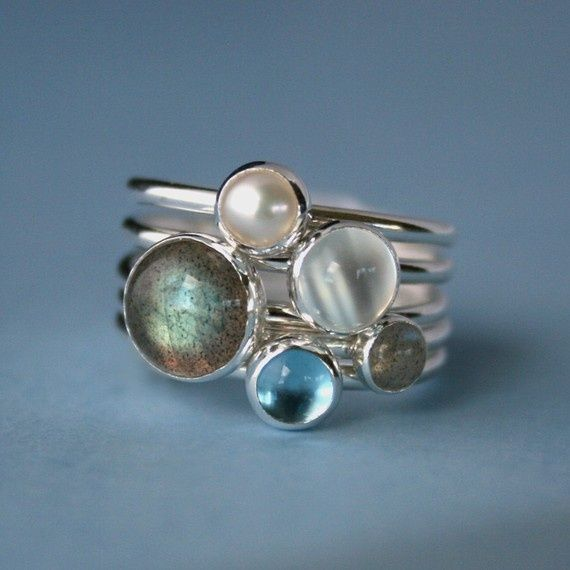 """""""Moonlight on Water"""" stacking rings.  Moonstone, labradorite, blue topaz, and pearl set in silver;  what's not to love?"""