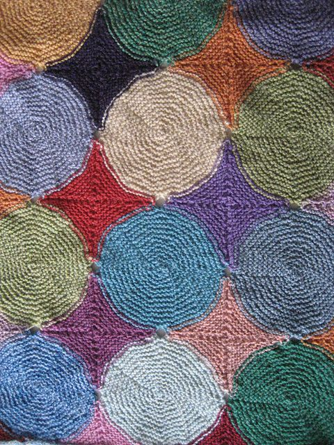 blanket knit from garter stitch circles.  interesting construction. twist collective.  poffertjes by moehge.
