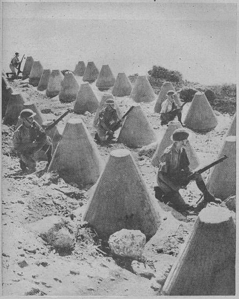 'British Troops in Syria', 1941. British troops in Syria during World War II, guarding a frontier position behind a concrete tank trap. From The War Illustrated: Volume 4 edited by Sir John Hammerton. [The Amalgamated Press Ltd, London, 1941] - pin by Paolo Marzioli