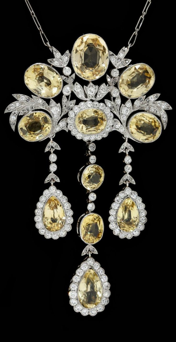 Attributed to Tiffany & Co. - An Antique Platinum, Yellow Sapphire and Diamond Necklace. 2 5/8 x 1.5 inches. Can also be worn as a brooch.