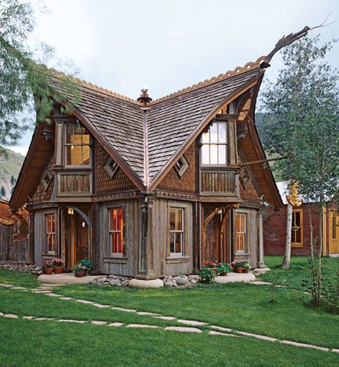 love the roof decorations on this wooden house in Colorado based on Norwegian stave church architecture
