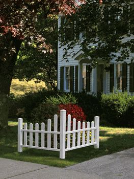 White corner picket fence good for front yard
