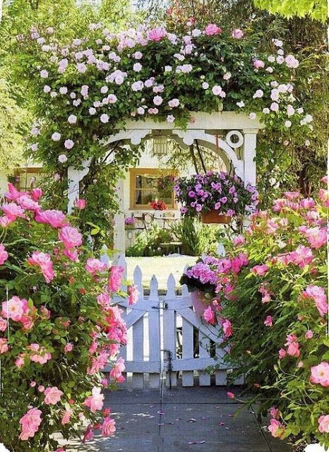 rose garden gate. The explosion of flowers adds to the storybook feel of this cottage