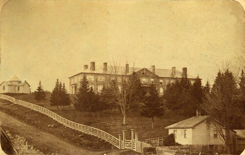 The University of New Brunswick Old Arts Building, before 1876, with the William Brydone-Jack Astronomical Observatory on the left. The first astronomical observatory built in British North America.