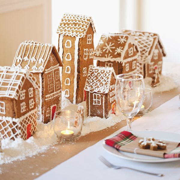 Gingerbread house centerpieces for a holiday dinner party