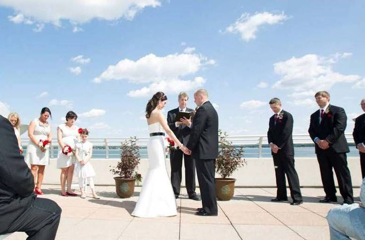 Brandy and Ryan tie the knot on a gorgeous  Madison summer afternoon! These two join together with their friends and family on the rooftop of Monona Terrace, over looking the calm Lake Monona.   Photograph taken by Heather Cook Elliot Photography
