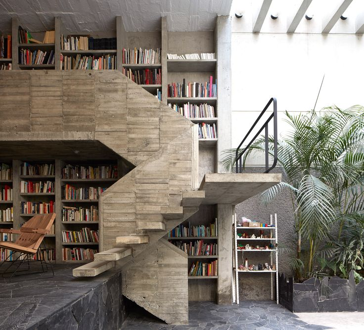 The Mexico City home and studio of sculptor Pedros Reyes and fashion designer Carla Fernandez features crazy paving, a concrete staircase and library.