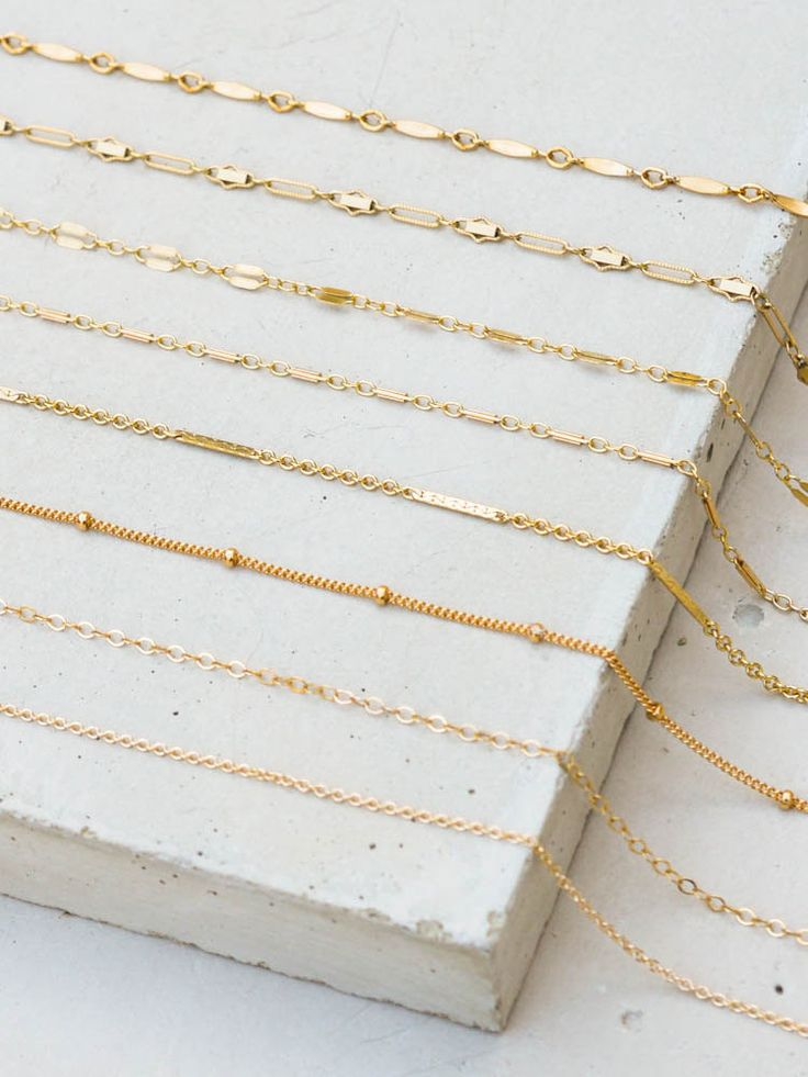 "You can customize your own choker by choosing the chain that you would like. Each choker is made of a gorgeous and dainty gold filled or sterling silver chain. Chokers measure 12"" with a 2"" extender."