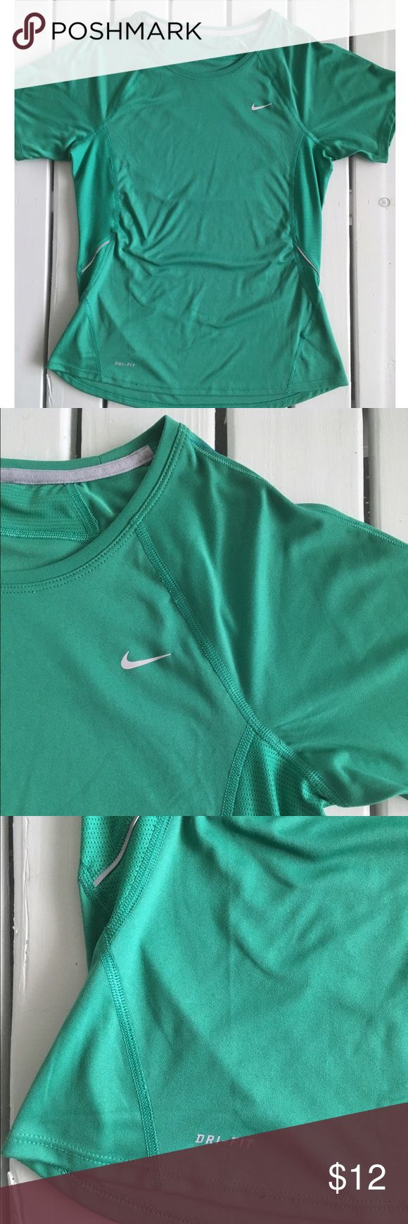 Nike Short Sleeve Dri-Fit Tee Green short sleeve Dri-Fit tee by Nike. This top features a scoop neck and the Nike logo at the chest. There are mesh panels on both side and at the nape accented with reflective trim. 100% polyester - machine wash/line dry per tag. Nike Tops Tees - Short Sleeve
