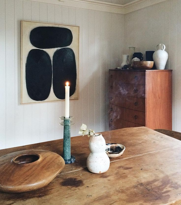 minimal rustic interior, wooden table, candlestick, objets