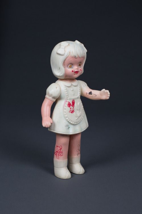tat girl (right side)12 1/2″ x 6″ x 2 1/2″resin stick, graphite,...