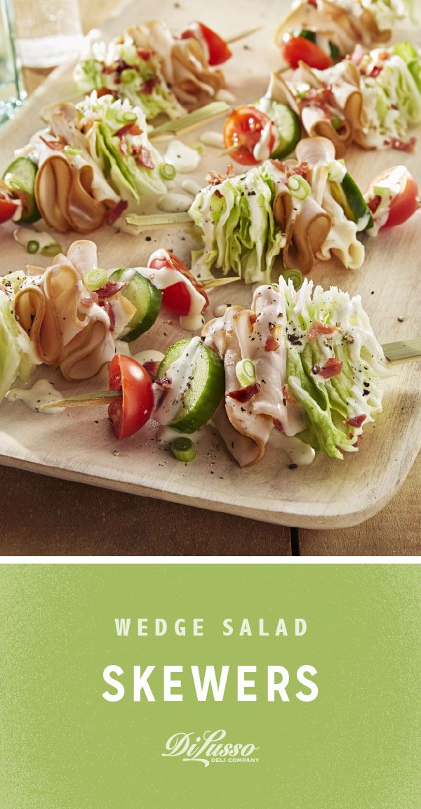 Refreshing and bright, these Smoked Chicken Wedge Salad Skewers are excellent for sharing at al fresco gatherings. They're piled high with cherry tomatoes, cucumbers, iceberg lettuce and DI LUSSO Applewood Smoked Chicken. Then topped with crispy bacon crumbles, creamy dressing and sliced green onions.