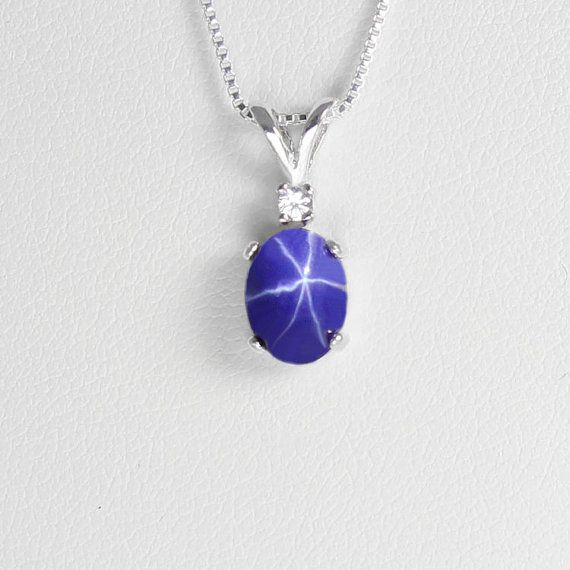 This sterling silver cornflower blue star sapphire necklace / pendant features a cornflower-colored star sapphire, accented by a synthetic diamond. The blue star sapphire gemstone has a floating 6-ray star which can be best observed under natural or artificial light. Please note, this blue star sapphire was lab-grown in a gemological lab.  The gemstones are set in a solid .925 sterling silver pendant setting, cast in the USA. Please feel free to email us if you have any questions. All of...
