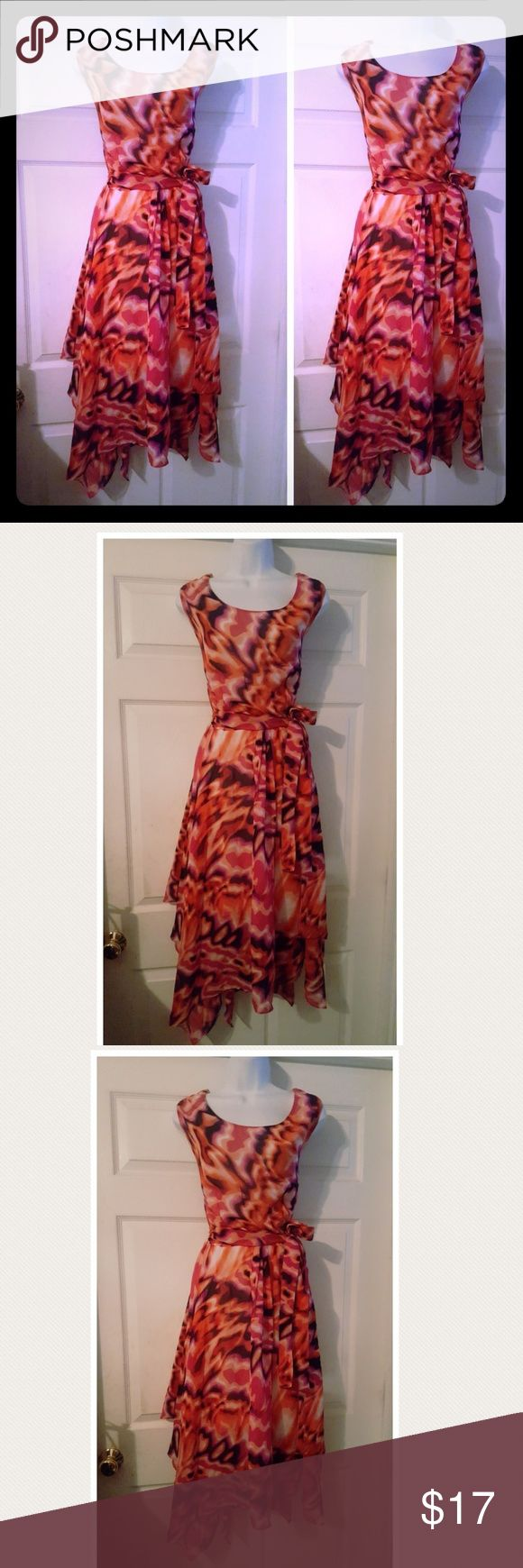 Beautiful orange ombre print handkerchief dress Beautiful orange ombre and white  print handkerchief dress with a flowy handkerchief hemline and a tie belt. Dress is sleeveless with a high round neckline. Dress is in excellent condition jennifer lauren plus Dresses