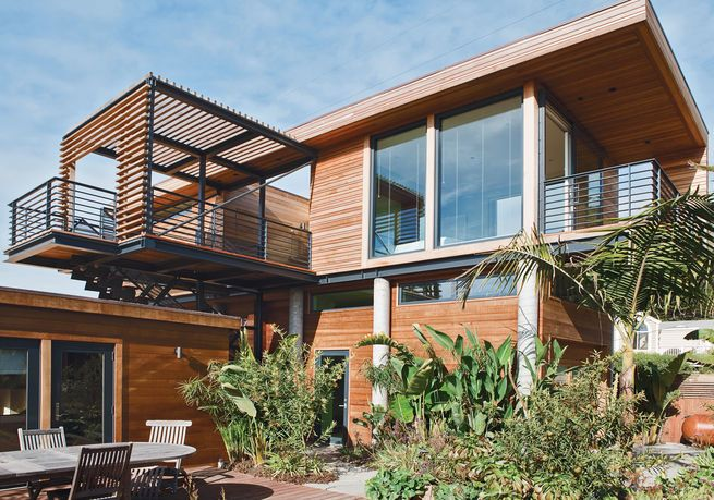 Varying types of wood comprise the exterior of this storm-proof home in Stinson Beach, California. Ipe decks jut out from several rooms.  Photo by: Mathew Scott