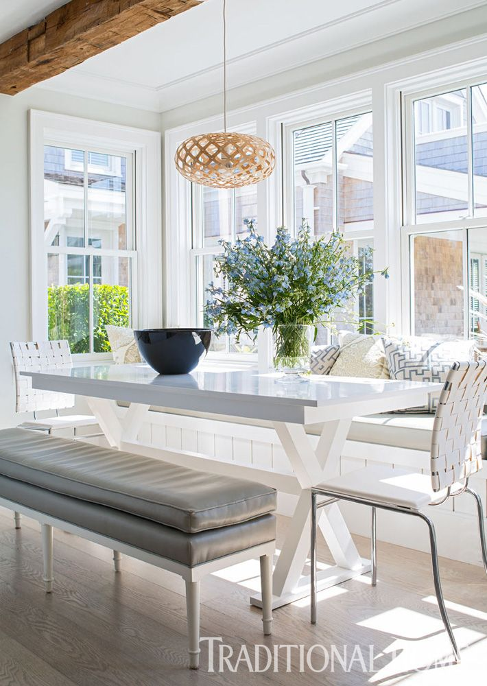 Sunlight streams in through double-hung windows surrounding the casual eating area. - Photo: John Bessler / Design: Cynthia Hayes